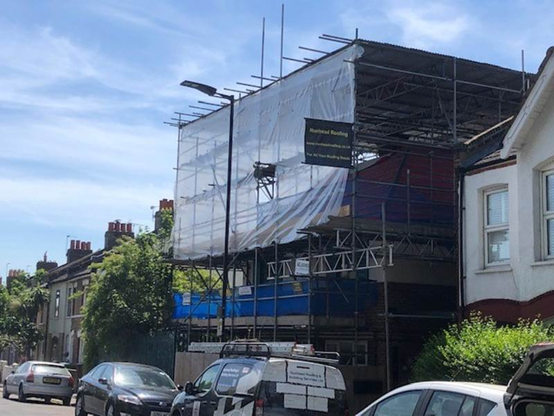 Nunhead roofers with van and scaffolding